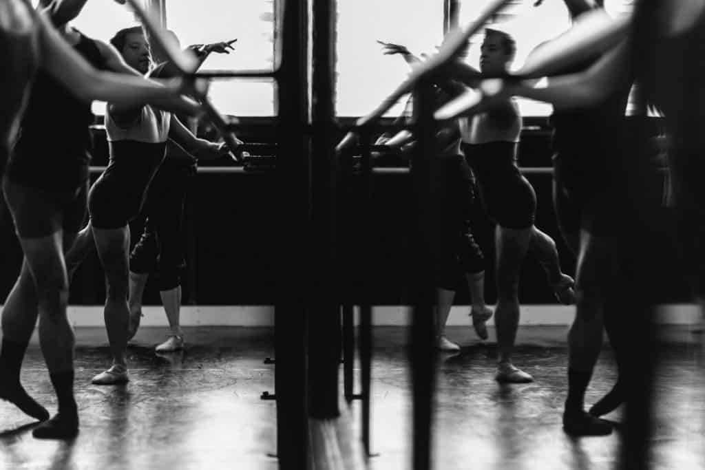 Dancers in front of mirror